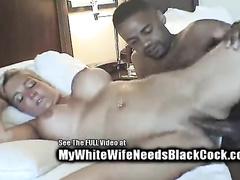 Leggy blondie enjoying hardcore interracial sex on the bed